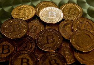 Bitcoin stumbles, but holds around $7,000 level