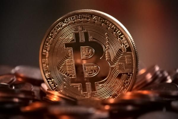 Bitcoin regains $7,000 as ETF decision looms
